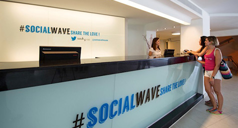"While most people vacationing in Majorca try to do no work, now there's a hotel for those who want to network. Spain's idyllic island is home to the Sol Wave House, where the guest experience revolves around tweets, hashtags, and networking. PSFK.com profiled the high-tech hotel to show why the digital destination has social seekers all atwitter.  Making its mark as the ""first Twitter experience hotel,"" the year-old Sol Wave House integrates social media into every aspect and amenity of the guest's visit. These include social-centric guest rooms, Twitter concierge assistance by hashtag, and an online community called #SocialWave where guests can tweet and meet each other.   The #SocialWave community is exclusive to guests and can only be joined by logging onto Twitter through a special app on the hotel's WiFi. Becoming part of the #SocialWave community lets guests see who else is online, learn where new friends are hanging out, tweet private messages, share photos, and send virtual kisses.   The community is designed to be an enjoyable and interactive way to enhance the hotel experience by making it easier for guests to do the social sharing they love to do.  In addition to the online community, the Sol Wave House infuses Twitter into its many fun features. Guests can first go to the #TwitterPoolParty on Fridays and treat themselves to Twitter-themed cocktails. Then they can hang out with their new social circle in a Twitter Party Suite, where up to four guests can party amidst bright blue balloons, hashtag licorice, and a mirror that prompts tweet-worthy moments. Later, they can get food by the pool by simply tweeting their order to @SolWaveHouse.   At the Sol Wave House, social seekers can engage in a truly virtual vacation.   Keep up with the latest on the social media scene. Contact MDG Advertising today at 561-338-7797 or visit mdgadvertising.com.  MDG Advertising is a full-service advertising agency and one of Florida's top creative ad agencies. With offices in Boca Raton and New York City, MDG's core capabilities include branding, logo design, print advertising, digital marketing, mobile marketing, email marketing, media planning and buying, TV and radio, outdoor advertising, newspaper, video marketing, Web design and development, content marketing, mobile marketing, social media marketing, and SEO. To stay on top of the latest trends in marketing and advertising, contact MDG Advertising today at 561-338-7797. To discover more about how social media communities can experience a shared sense of social support and solidarity, check out ""Twitter Users Demonstrate ""Tribe"" Tendencies."""